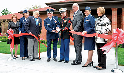 Gretchen Lizza (far left) at the opening of Fisher House II.